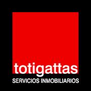 Logo totigattas servicios inmobiliarios